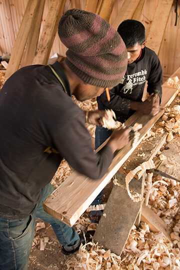 Artisans stripping wood