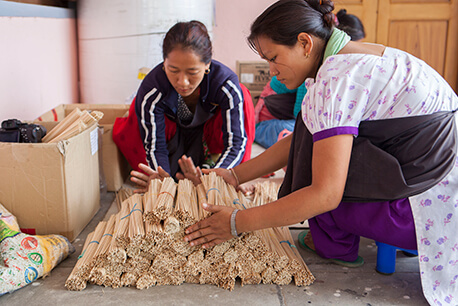 Artisans stacking dowels for lina